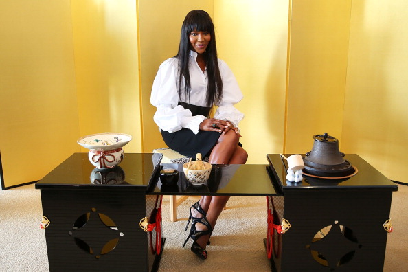 She attended a tea ceremony wearing a balloon sleeve blouse and sky high stilettos.