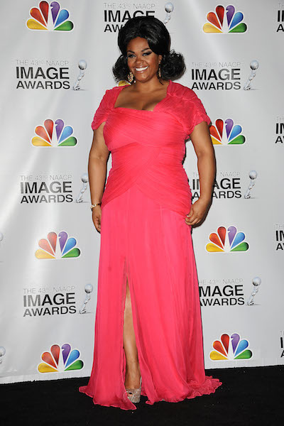 Jill Scott poses in costume in the press room at the 43rd annual NAACP Image Awards