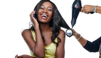Black Woman Getting Hair Done