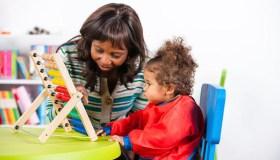 women babysitting child
