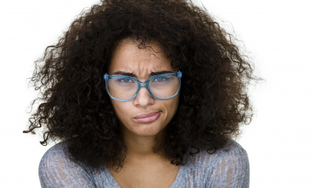 Mixed race woman with a displeased expression