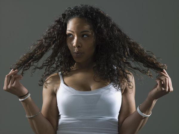 Woman holding hair, looking away
