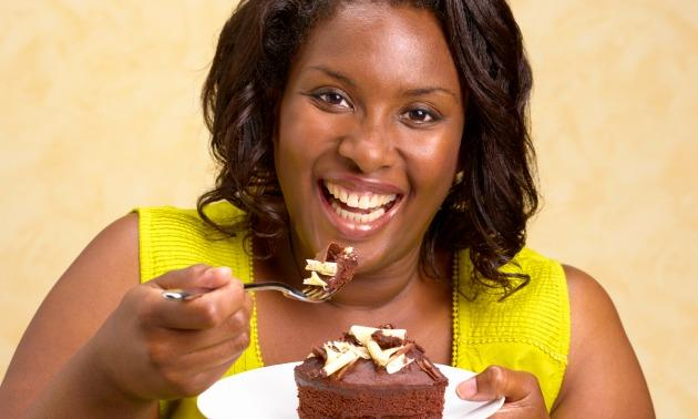 Black woman eating cake