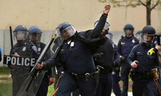 Cop Throws Rocks At Baltimore Protestors