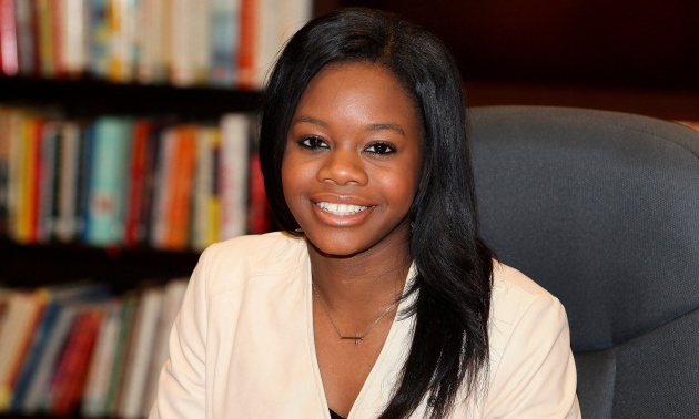 Gabby Douglas Book Signing For 'Raising The Bar' In Skokie, Illinois.
