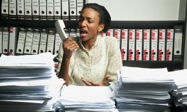 Black woman screaming on phone