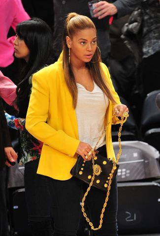 Beyonce in yellow blazer