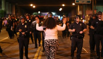 Protestor Holding Her Hands Up