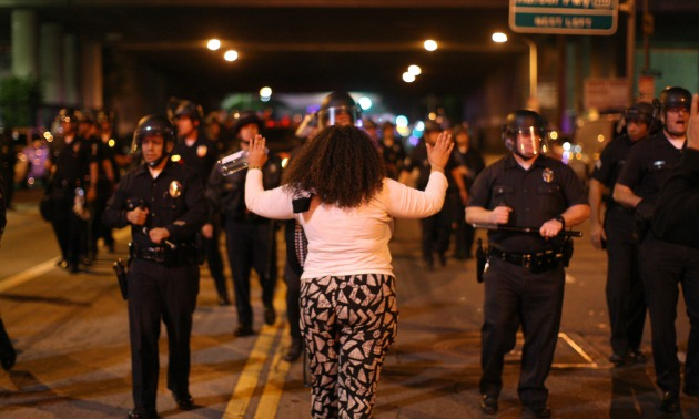 Protestor Holding Her Hands Up