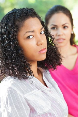 Serious young woman angry with friend