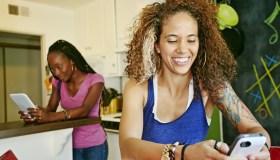 Women using technology in kitchen