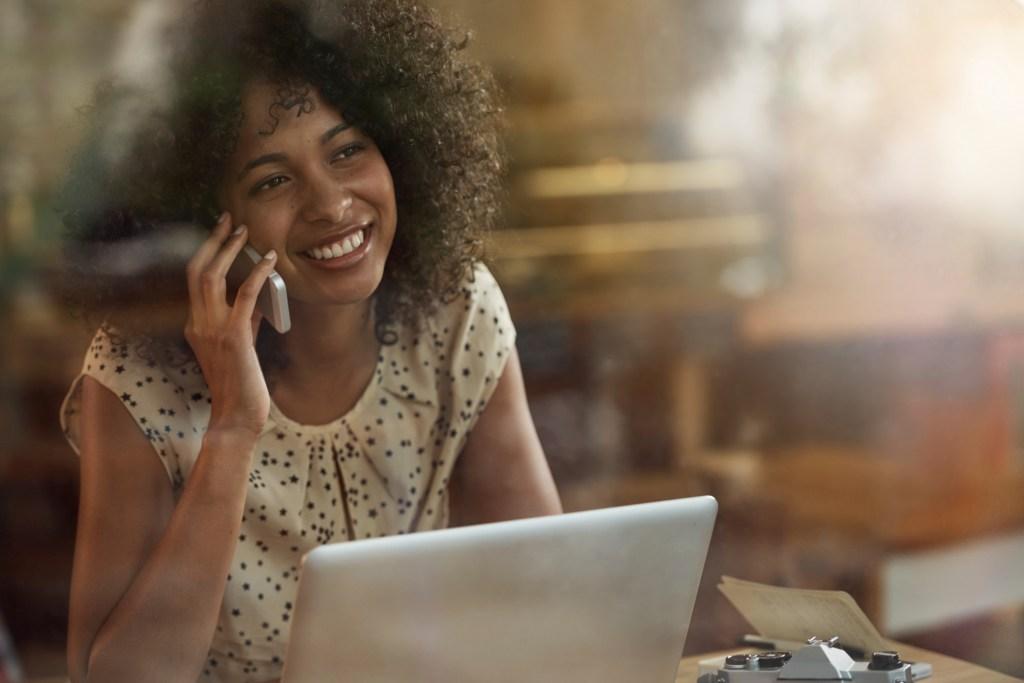 Black woman on phone & computer