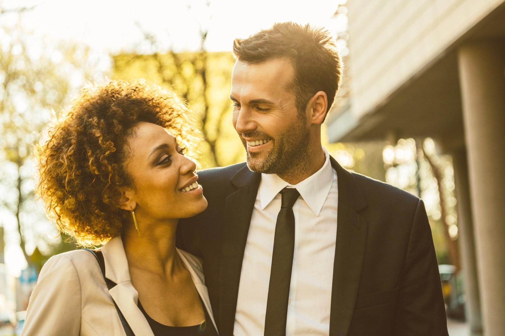 Outdoor portrait of flirting elegant couple