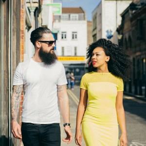 Couple Walking Through The City