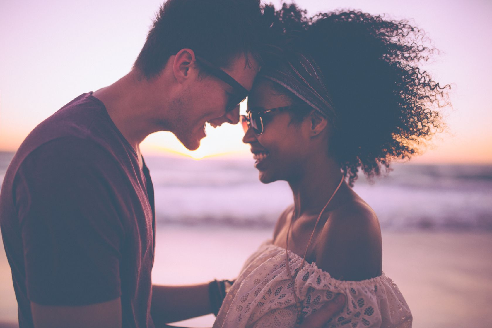 Mixed race couple sharing a romantic moment at sunset