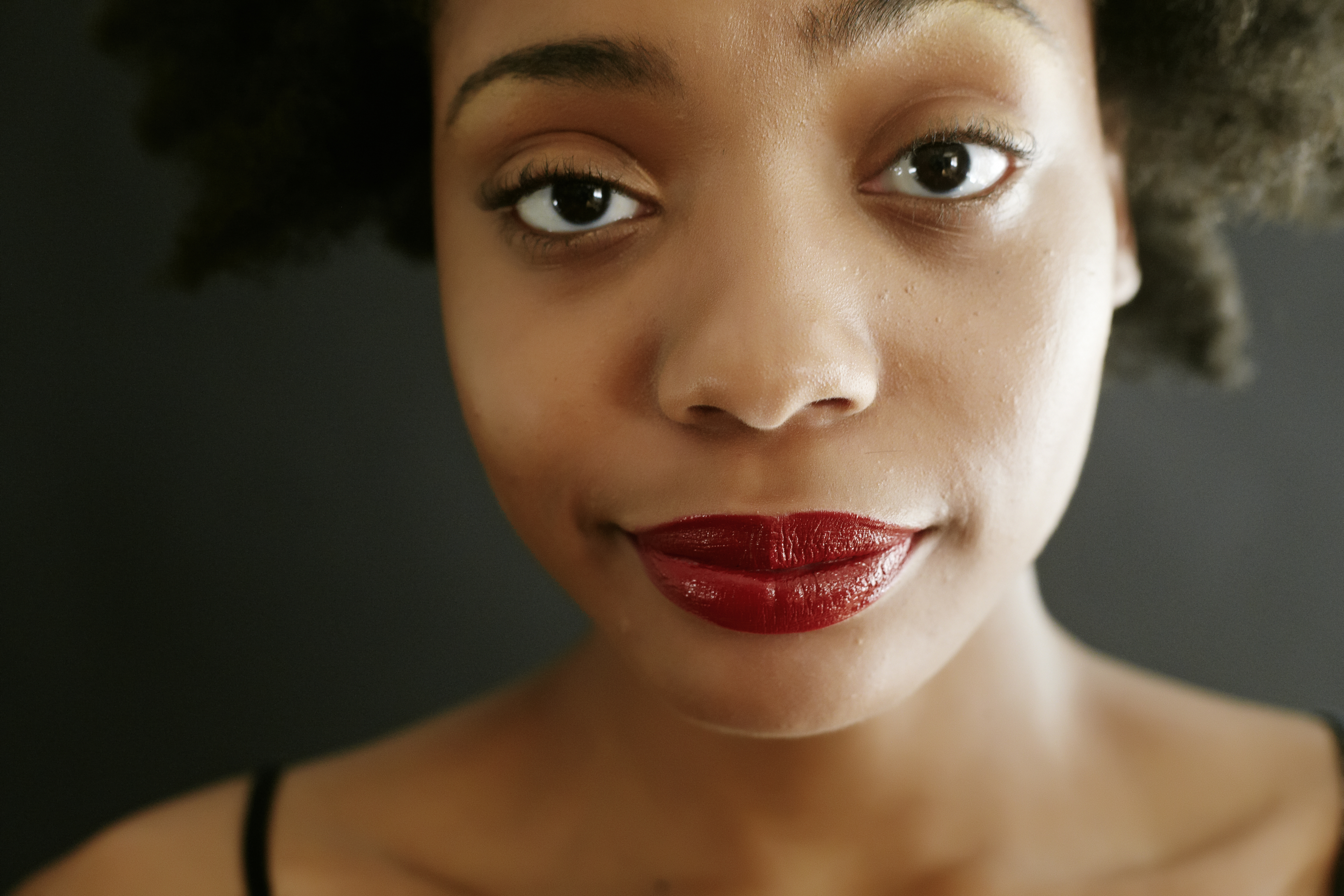 Close up of black woman smirking