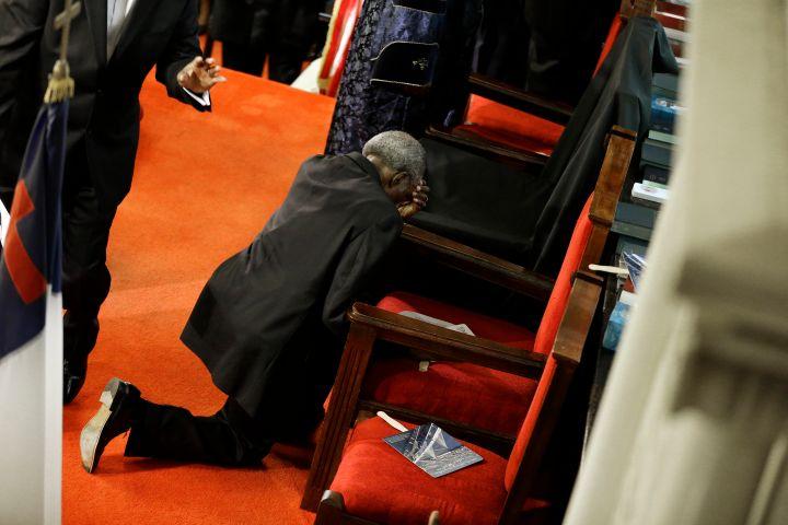 Kneeled down in prayer