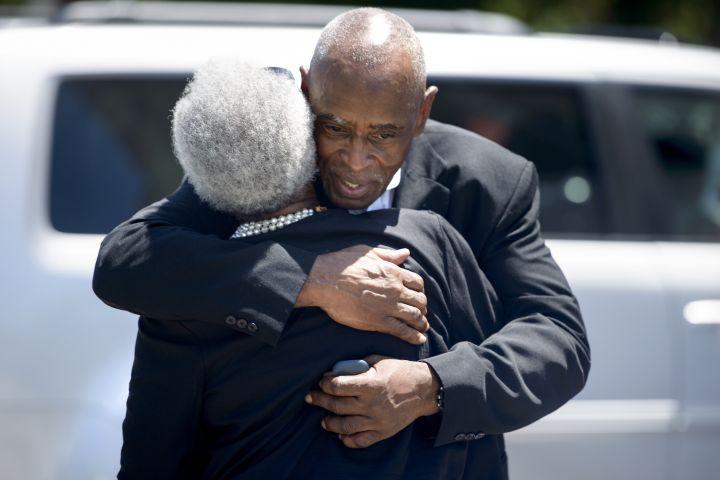 Mourning Church Members Embrace
