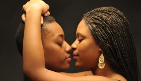 African American Lesbian Couple Embracing Touching