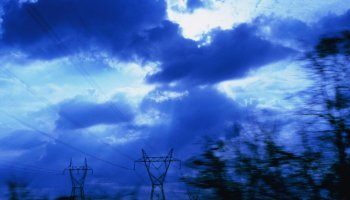 Cloudy sky with silhouetted power lines
