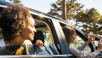 Black woman in car feature image