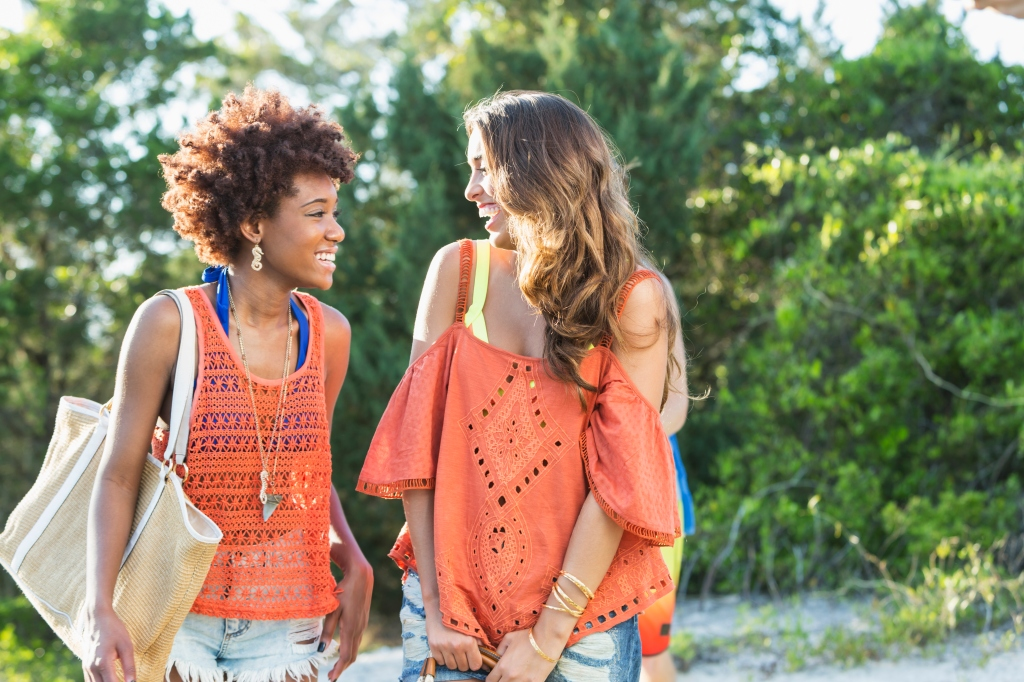 Two young multiracial women on summer day