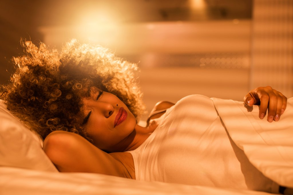 African American woman napping.