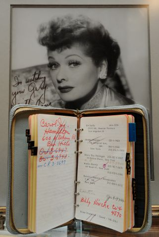 An address book and a photo of TV person