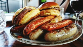Hamburgers And Sausages On Plate