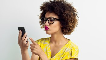 Afro American Young Woman using smart phone