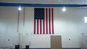 American flag in a school gym