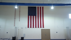 American flag in a school gym