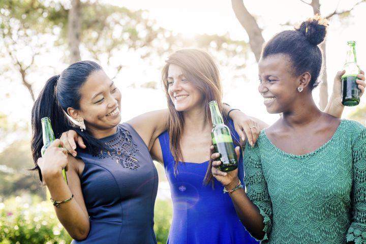 Three young women having fun at the park
