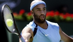 James Blake gets the ball right on the racket during a forehand shot against Roger Federer in the f