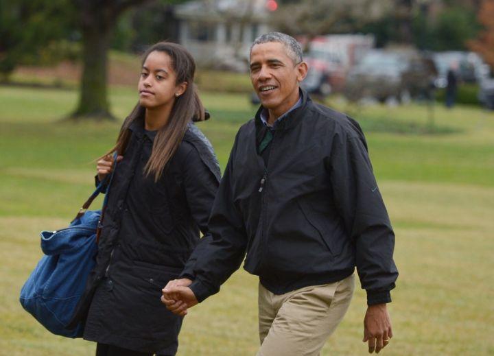 Malia & Dad On A Stroll