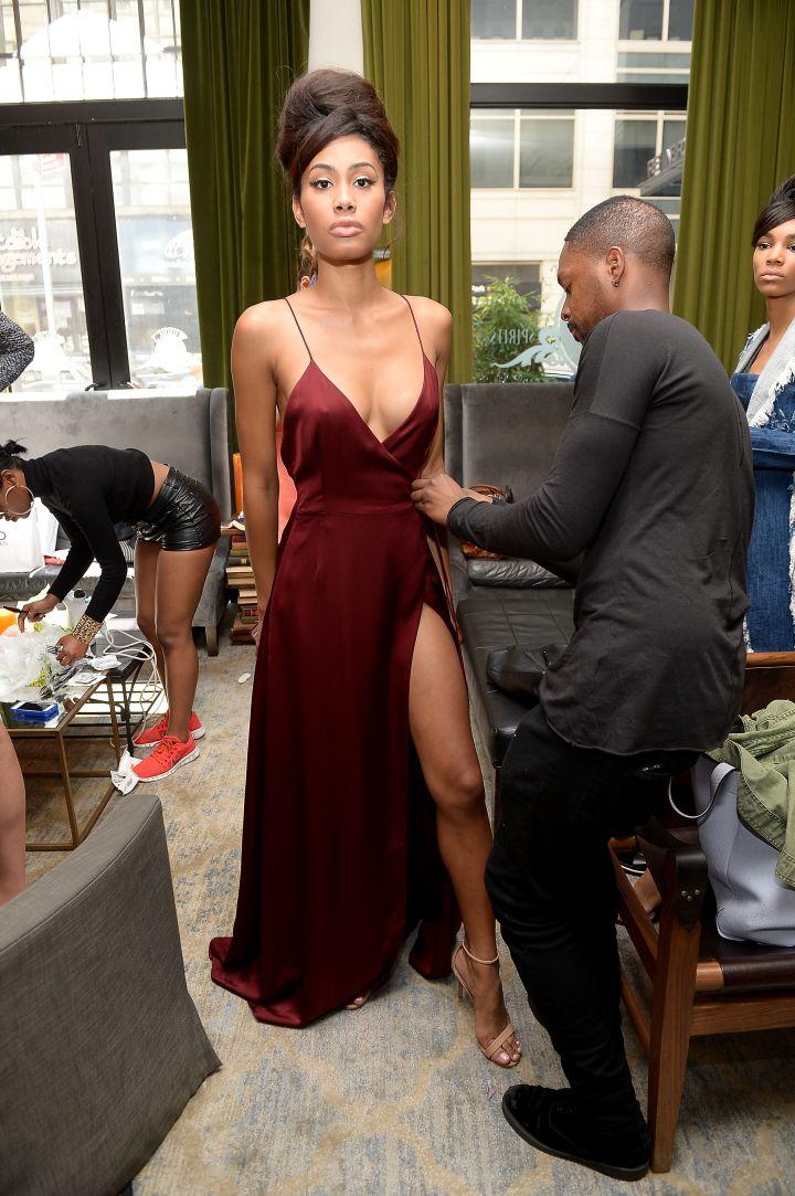 Laquan Smith adjusts a garment on model.