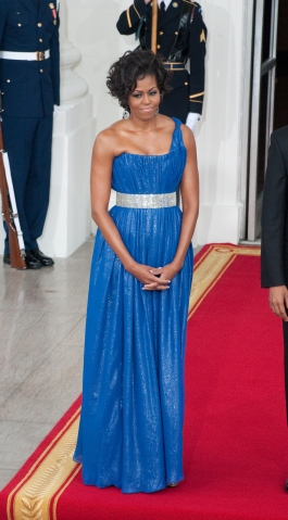 First Lady Michelle Obama waits to greet His Excellency...
