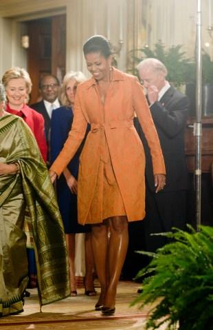 First Lady Michele Obama waits for U.S. President Barack...