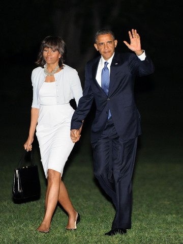 President Obama and first lady Michelle Obama return to the White House