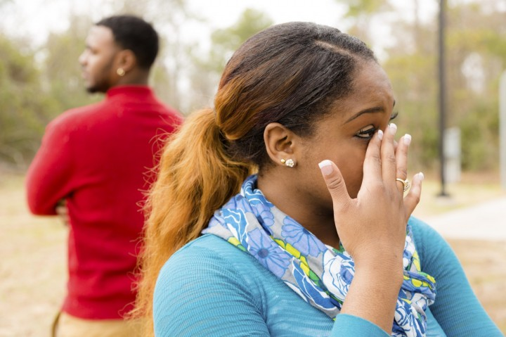 Conflict, arguement between African descent couple. Sadness, crying, anger.