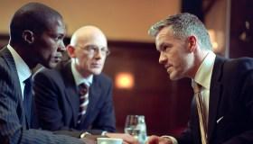 Three businessmen discussing in bar, close-up,