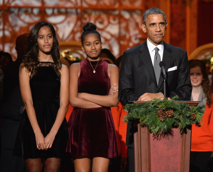 BARACK OBAMA AND HIS DAUGHTERS AT TNT CHRISTMAS IN WASHINGTON, 2014