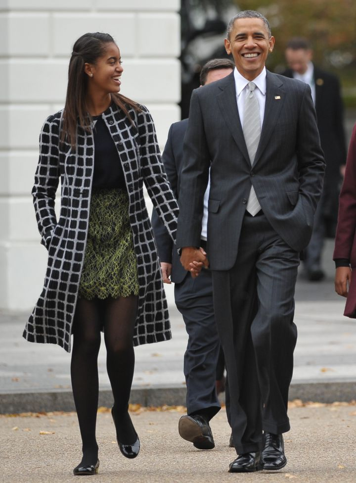 Malia Is Never Too Old To Hold Dad's Hand