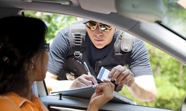 Crime: Policeman gives driver a traffic ticket.