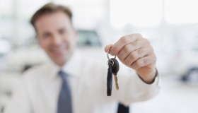 Close up of car salesman holding keys