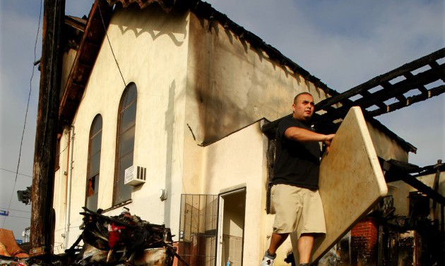 Volunteers help to salvage tables, chairs and other items that were not burnt in the fire that dest