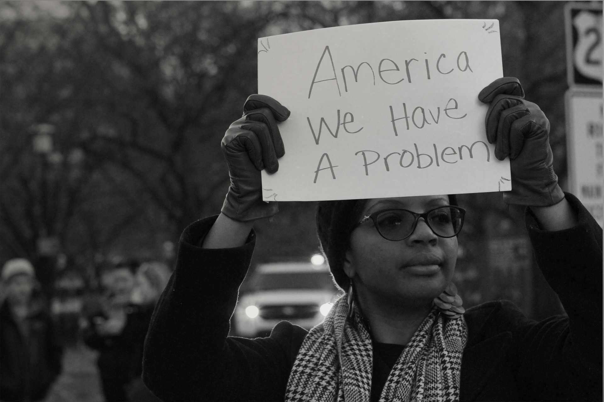 Black Woman Holding Protest Sign