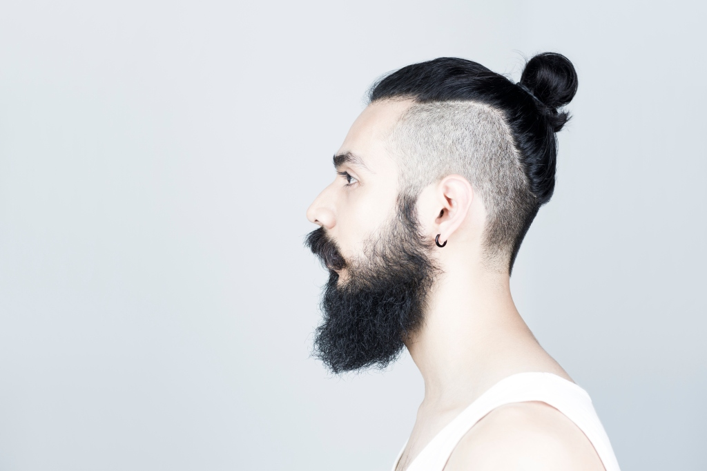 Profile of man with beard and half shaved hair
