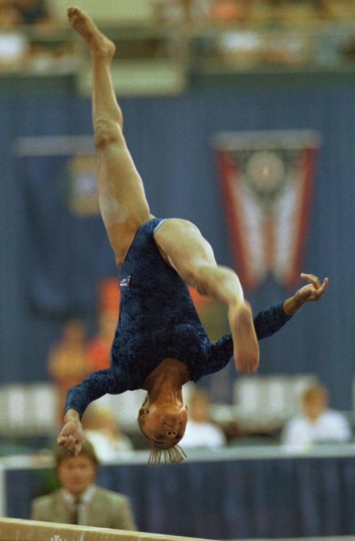 Performing This No Handed Back Walkover On The Balance Beam