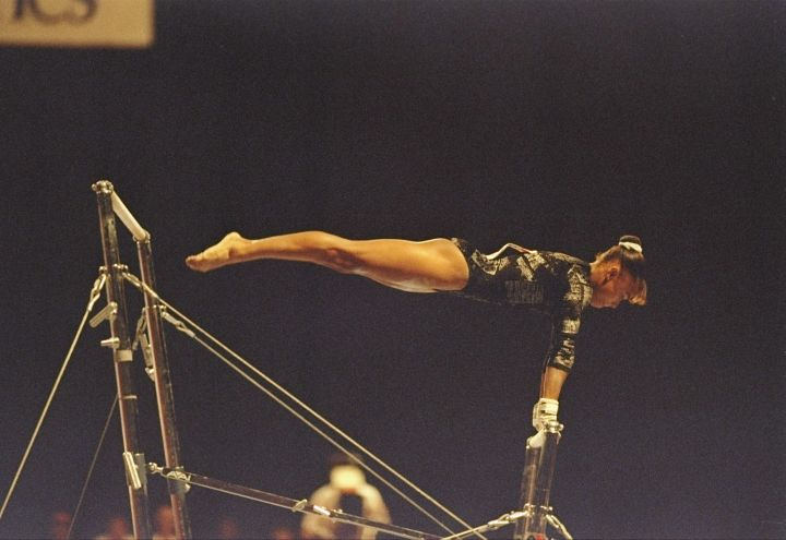 On The Uneven Bars At The USA Gymnastics Nationals at the Louisiana Superdome